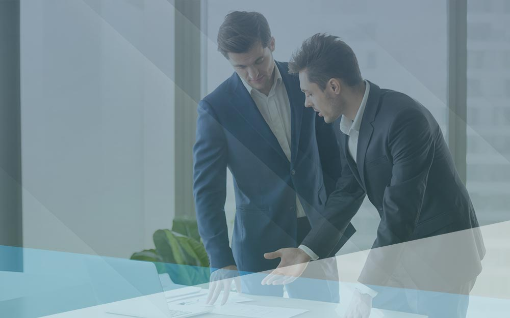 Two businessmen discussing a project together