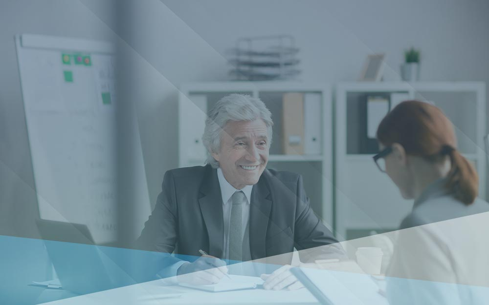 Businessman discussing business management with female colleague