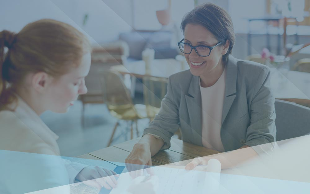 Businesswoman teaching and guiding another office executive