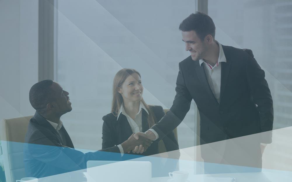 Cheerful businessmen handshaking after an interview