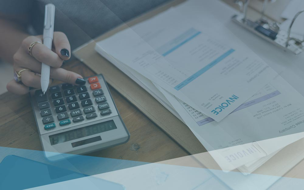 Business accountant calculating invoices