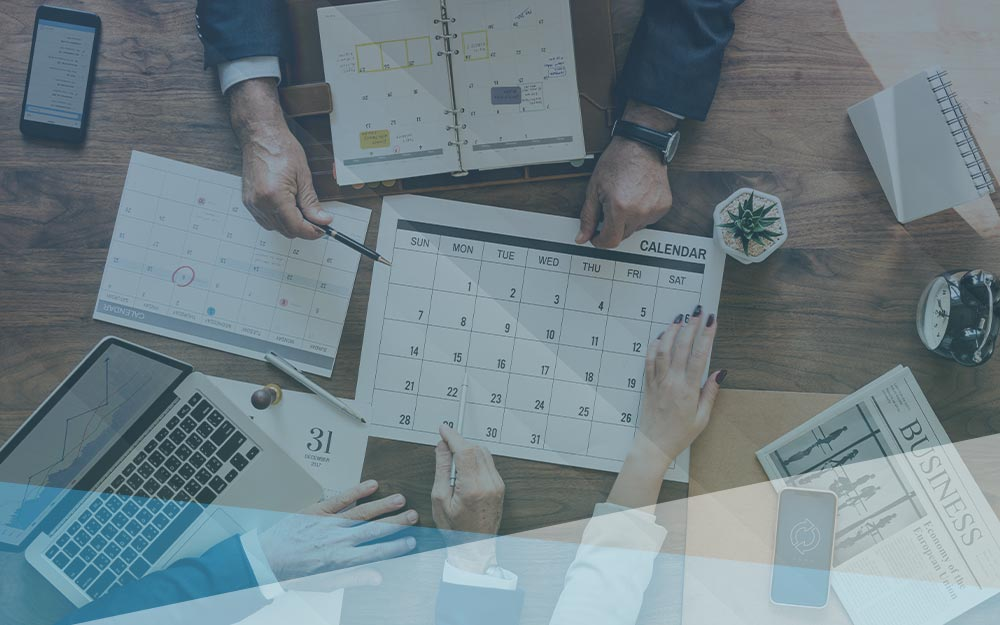 Office managers planning and scheduling business finances